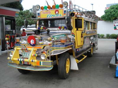 Packing the kids in. 60+ Public Transportation Jeepneys