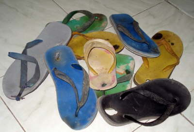 To protect the kids from infections and worms we exchange their worn out sandals for new ones. 2 pairs for $1